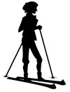 Silhouette skiing girl a of a on skis Stock Image