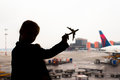 Silhouette of a small airplane model on airport in kids hands Royalty Free Stock Photo