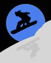Silhouette of snowboarder in the moonlight blue coming down a snowy mountain Stock Photos