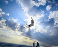 Silhouette the snowboarder in the sky Stock Photo
