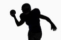 Silhouette sportsman throwing football Royalty Free Stock Photo