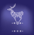 Silhouette of stanging deer formed by snowflakes christmas background standing reindeer in Stock Image
