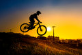Silhouette of stunt bmx rider color tone tuned Stock Images