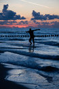 Silhouette of surfer on beach Royalty Free Stock Images