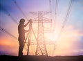 Silhouette survey engineer working over Blurred high voltage tr