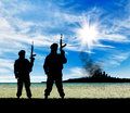 Silhouette of terrorists concept a terrorist attack with a rifle on a background the city in smoke Royalty Free Stock Image