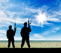 Silhouette of terrorists concept a terrorist attack with a rifle on the beach Royalty Free Stock Photos