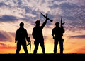 Silhouette of a terrorists concept terrorist with rifle at sunset Royalty Free Stock Photo