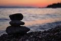 Silhouette of three zen rocks on the beach Royalty Free Stock Photo