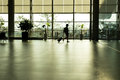 Silhouette traveler man  walking in airport terminal gate Royalty Free Stock Photo