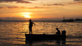 Silhouette Of Two Fishermen On...