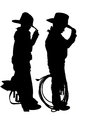 Silhouette of two young cowboys Royalty Free Stock Photo