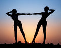 Silhouette of two young women Stock Photo