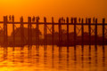 Silhouette of U bein bridge at sunset Stock Photography