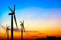 Silhouette wind turbine generator with factory emissions of carb carbon credits concept carbon dioxide on sunset background Royalty Free Stock Photography