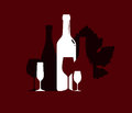 Silhouette of wine bottles and wineglasses on the background of grape leaf Royalty Free Stock Photo