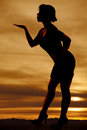 Silhouette of a woma blowing a kiss woman with beautiful sunset Royalty Free Stock Photo