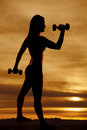 Silhouette woman hammer curl Royalty Free Stock Photo