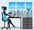 Silhouette of a woman with a laptop on the background window Royalty Free Stock Photography