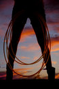 Silhouette woman legs rope front a of a with her by her Royalty Free Stock Images