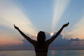 Silhouette Of Woman With Outstretched Arms On Beach Royalty Free Stock Photo