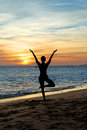 Silhouette woman  practicing yoga on sunset Stock Photography