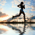 Silhouette woman run under blue sky with clouds Royalty Free Stock Photos