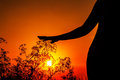 Silhouette of woman's body at sunset Royalty Free Stock Photo