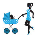 Silhouette of a woman with a stroller baby in Stock Photo
