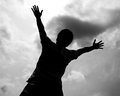 Silhouette of worship man lift ut his hand to pray and praise in black and white Stock Photo