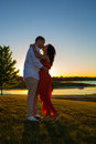 Silhouette of Young Couple Kiss Sunset Royalty Free Stock Image