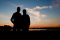 Silhouette of a young couple at sunset the Stock Image