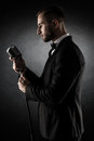 Silhouette of young handsome singer on black background. Royalty Free Stock Photo