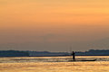 Silhouette of young man in a canoe along the Napo Royalty Free Stock Photo
