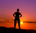 Silhouette of young man in the mountains at sunset Royalty Free Stock Images