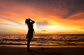 Silhouette of young woman portrait by the sea when sunset girl enjoying herself with such magnificent view karon beach phuket Royalty Free Stock Photos