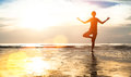 Silhouette young woman practicing yoga on the beach at sunset. Nature. Royalty Free Stock Photo