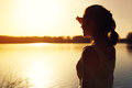 Silhouette of young woman watching sunset nature Royalty Free Stock Photo