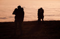 Silhouetted couples kissing above inversion fog