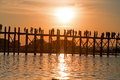 Silhouetted people on U Bein Bridge at sunset, Amarapura, Mandalay Myanmar Royalty Free Stock Photo