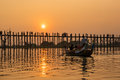 Silhouetted people on U Bein Bridge Royalty Free Stock Photo