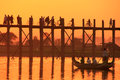 Silhouetted people on U Bein Bridge at sunset, Amarapura, Myanma Royalty Free Stock Photo