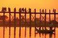 Silhouetted people on U Bein Bridge at sunset, Amarapura, Myanma Royalty Free Stock Photo