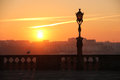 Silhouetted street lamp at sunset porto portugal a view from the cathedral square Stock Image