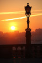 Silhouetted street lamp at sunset porto portugal a view from the cathedral square Royalty Free Stock Photo