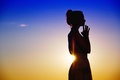 Silhouetted woman deep in thought Royalty Free Stock Photo