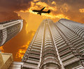 Silhouettes airplane flying landing over modern skyscrapers Royalty Free Stock Photo