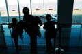 Silhouettes at airport Stock Images