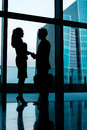 Silhouettes of backlit business people handshake Royalty Free Stock Photo