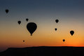 Silhouettes of balloon over sunrise in Cappadocia, Turkye Royalty Free Stock Photo